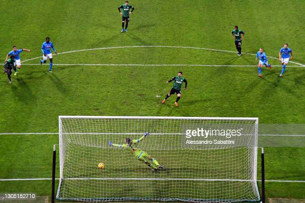 Francesco Caputo of Sassuolo scores their team's third goal from the penalty spot past Alex Meret of Napoli during the Serie A match between US...