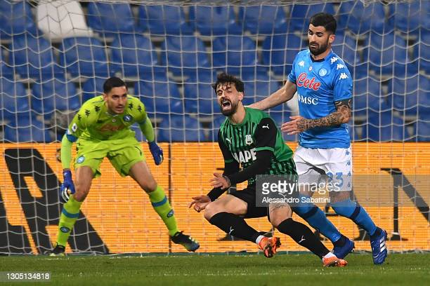 Francesco Caputo of U.S. Sassuolo Calcio is challenged by Elseid Hysaj of SSC Napoli leading to a penalty being awarded during the Serie A match...