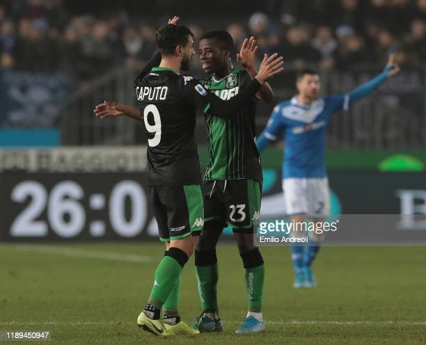 Francesco Caputo of US Sassuolo celebrates his goal with his teammate Hamed Junior Traore during the Serie A match between Brescia Calcio and US...