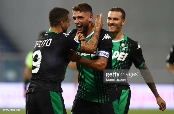 Francesco Caputo of US Sassuolo celebrates his goal with his team-mate Domenico Berardi during the Serie A match between US Sassuolo and Genoa CFC at...