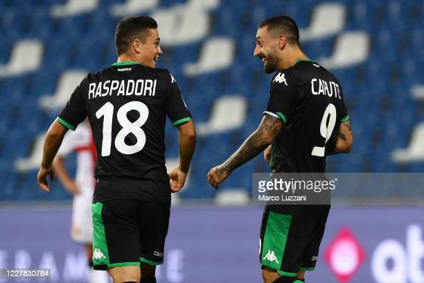 Francesco Caputo of US Sassuolo celebrates his second goal with his team-mate Giacomo Raspadori during the Serie A match between US Sassuolo and...
