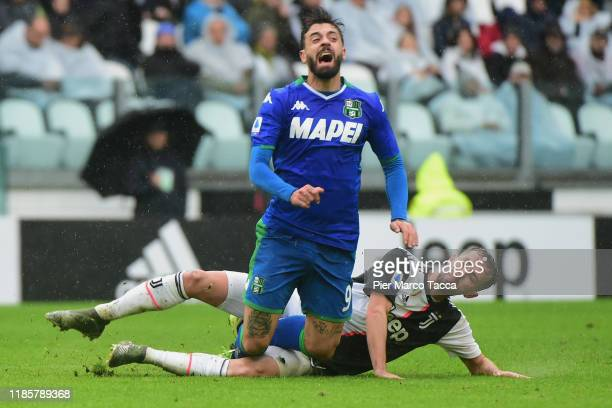 Francesco Caputo of US Sassuolo competes for the ball with Miralem Pjanic of Juventus during the Serie A match between Juventus and US Sassuolo at on...