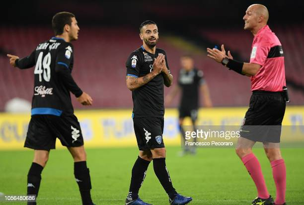 Francesco Caputo player of Empoli argue with referee Luca Pairetto during the Serie A match between SSC Napoli and Empoli at Stadio San Paolo on...