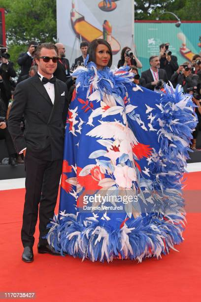 Francesco Carrozzini and Iman walk the red carpet ahead of the Opening Ceremony and the La Vérité screening during the 76th Venice Film Festival at...
