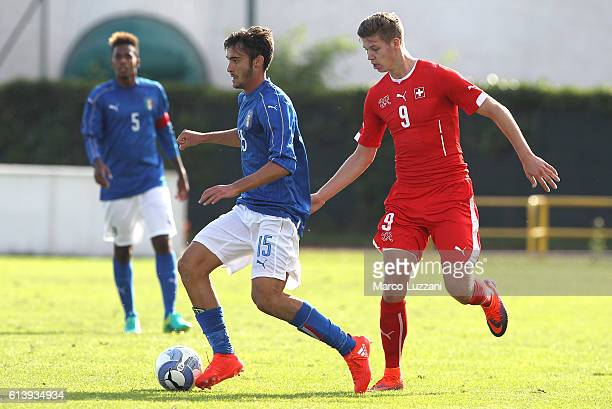 Francesco Cassata of Italy is challenged by Cedric Itten of Switzerland during the Four Nations tournament match between Italy U20 and Switzerland...