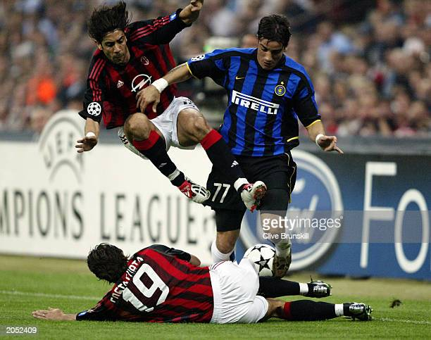 Francesco Coco of Inter Milan is tackled by both Rui Costa and Alessandro Costacurta of AC Milan during the UEFA Champions League SemiFinal First Leg...