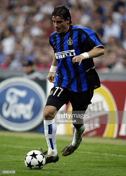 Francesco Coco of Inter Milan runs with the ball during the UEFA Champions League SemiFinal First Leg match between AC Milan and Internazionale...