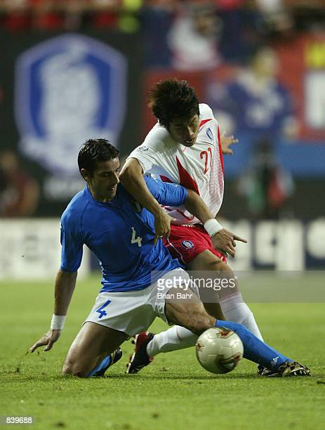 Francesco Coco of Italy wins the tackle against Ji Sung Park of South Korea during the FIFA World Cup Finals 2002 Second Round match played at the...