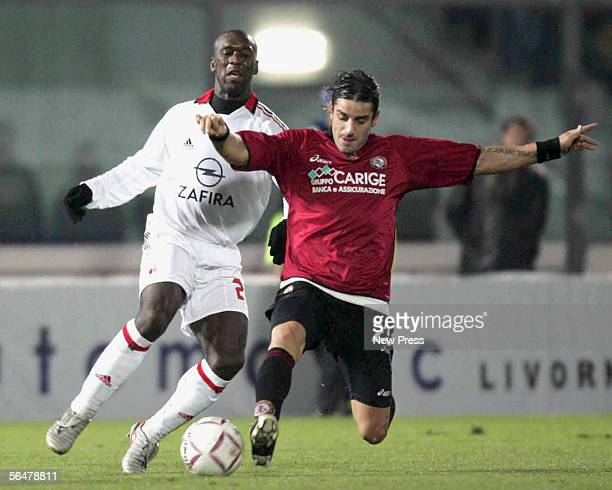 Francesco Coco of Livorno in action against Clarence Seedorf of Milan during the Serie A match between Livorno and AC Milan at the Stadio Armando...