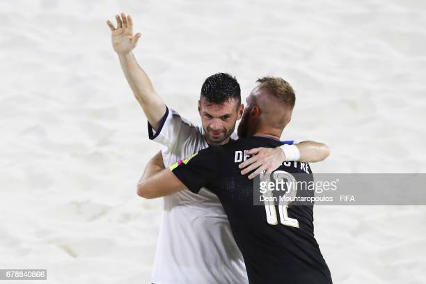 Francesco Corosiniti and Simone Del Mestre of Italy celebrate victory after the FIFA Beach Soccer World Cup Bahamas 2017 quarter final match between...