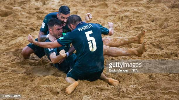Francesco Corosiniti of Italy celebrates a goal with his teammates during the FIFA Beach Soccer World Cup Paraguay 2019 semi final match between...