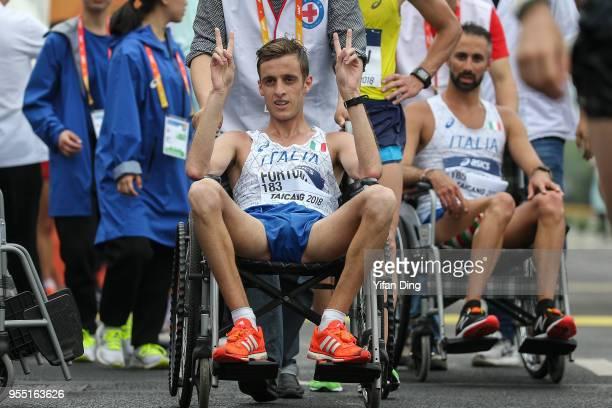 Francesco Fortunato of Italy celebrates after finishing 9th during Men's 20 kilometres Race Walk of IAAF World Race Walking Team Championships...