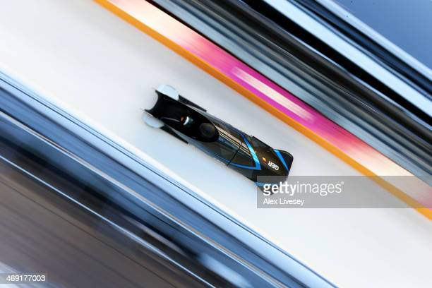 Francesco Freidrich of Germany pilots a run during a Men's Twoman Bobsleigh training session on day 6 of the Sochi 2014 Winter Olympics at the Sanki...