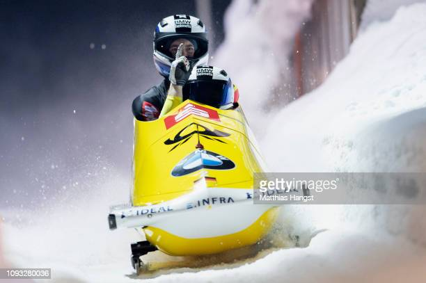 Francesco Friedrich and Martin Grothkopp of Germany celebrate winning the BMW IBSF Men's 2Man Bobsleigh World Cup and European Championships at...