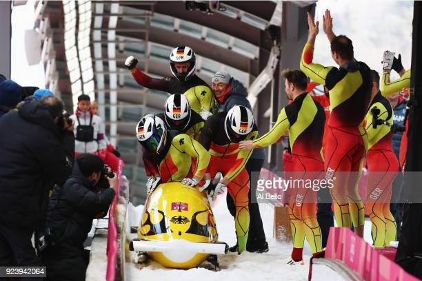 Francesco Friedrich Candy Bauer Martin Grothkopp and Thorsten Margis of Germany celebrate winning gold as they finish their final run during the 4man...