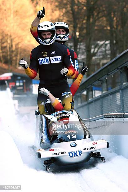 Francesco Friedrich, Jannis Baecker, Gregor Bermbach and Thorsten Margis of Germany celebrate their second place after the second run of the four man...