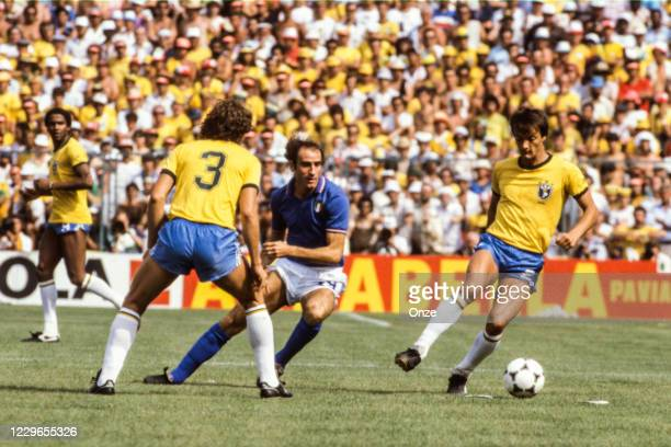 Francesco Graziani of Italy and Leandro of Brazil during the second stage of the 1982 FIFA World Cup match between Italy and Brazil, at Sarria...