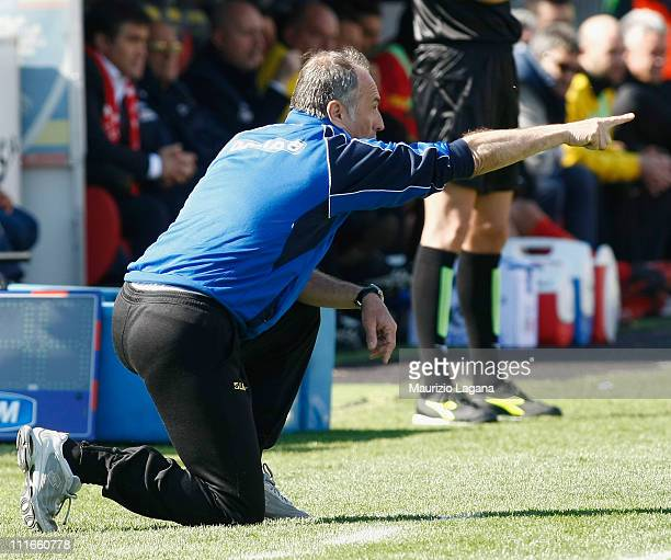 Francesco Guidolin coach of Udinese gestures during the Serie A match between US Lecce and Udinese Calcio at Stadio Via del Mare on April 3 2011 in...