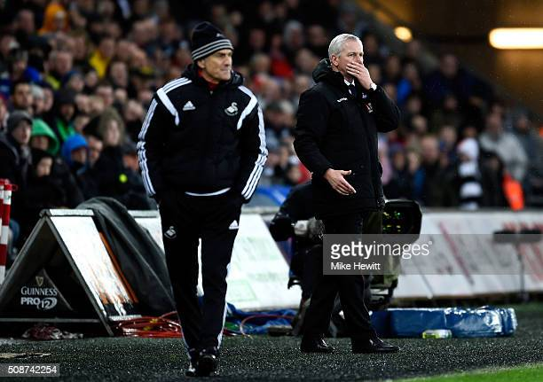 Francesco Guidolin Manager of Swansea City and Mark Hughes manager of Stoke City look on during the Barclays Premier League match between Swansea...