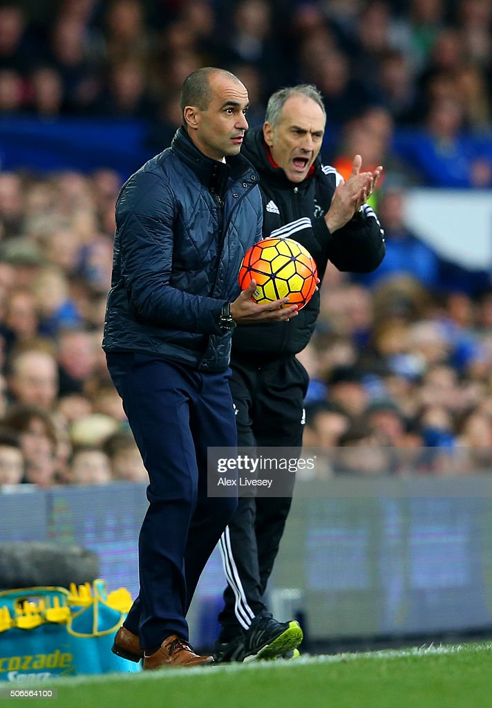 Francesco Guidolin, Manager of Swansea City encourages his players next to Roberto Martinez, Manager of Everton during the Barclays Premier League match between Everton and Swansea City at Goodison Park on January 24, 2016 in Liverpool, England.
