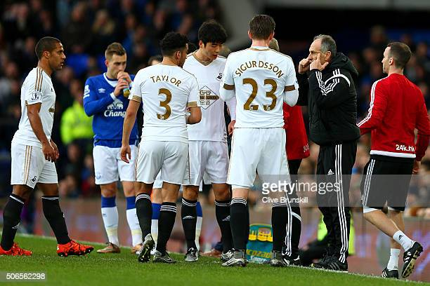 Francesco Guidolin Manager of Swansea City speaks with his players during the Barclays Premier League match between Everton and Swansea City at...