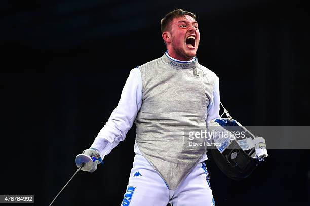 Francesco Ingargiola of Italy celebrates as he competes in the Men's Team Foil Final during day fifteen of the Baku 2015 European Games at the...