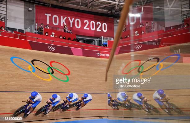 Francesco Lamon, Simone Consonni, Jonathan Milan and Filippo Ganna of Team Italy sprint to set a new Olympic record during the Men´s team pursuit...