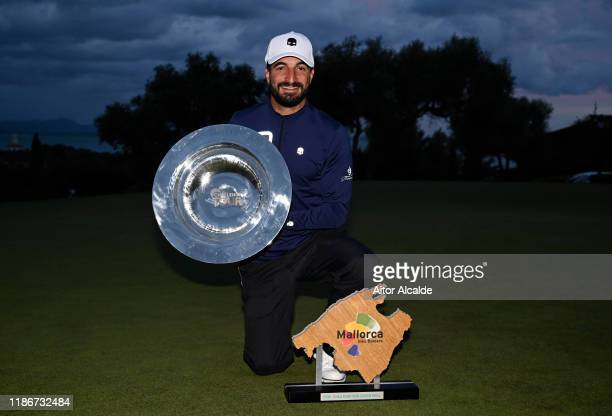 Francesco Laporta of Italy poses with the trophy during day 4 of the Challenge Tour Grand Final at Club de Golf Alcanada on November 10 2019 in...