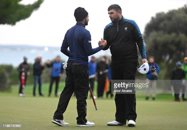 Francesco Laporta of Italy shakes hands with Jack Senior of England during day 4 of the Challenge Tour Grand Final at Club de Golf Alcanada on...