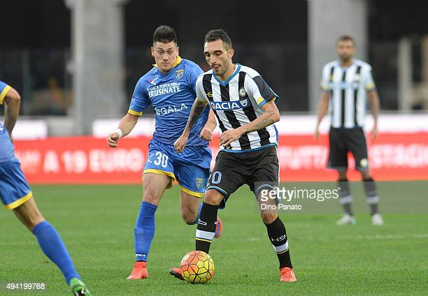 Francesco Lodi of Udinese Calcio competes with Nicolas Castillo of Frosinone Calcio during the Serie A match between Udinese Calcio and Frosinone...