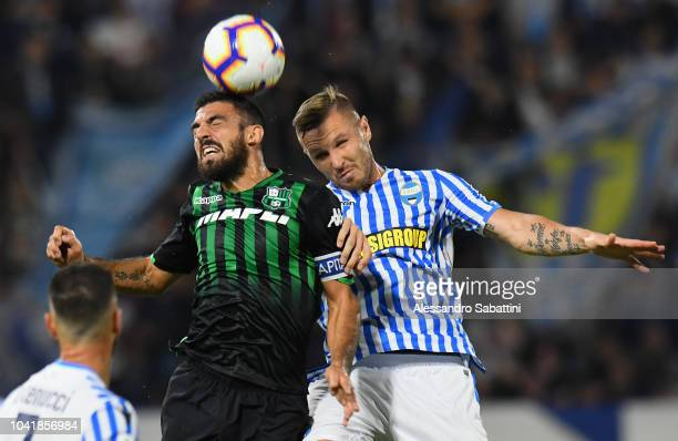 Francesco Magnanelli of Sassuolo competes for the ball with Jasmin Kurtic of Spal during the serie A match between SPAL and US Sassuolo at Stadio...