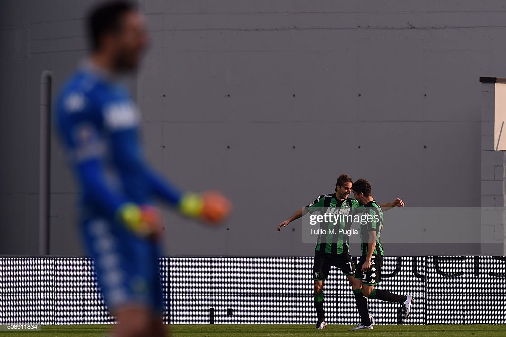 Francesco Magnanelli (L) of Sassuolo scores after scoring his team's second goal during the Serie A match between US Sassuolo Calcio and US Citta di Palermo at Mapei Stadium - Città del Tricolore on February 7, 2016 in Reggio nell'Emilia, Italy.