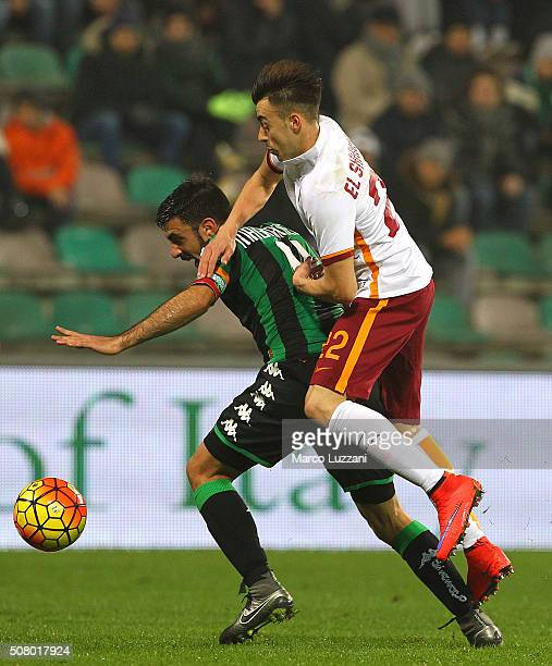 Francesco Magnanelli of US Sassuolo Calcio competes for the ball with Stephan El Shaarawy of AS Roma during the Serie A match between US Sassuolo...