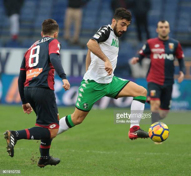 Francesco Magnanelli of US Sassuolo Calcio is challenged by Andrea Bertolacci of Genoa CFC during the serie A match between Genoa CFC and US Sassuolo...