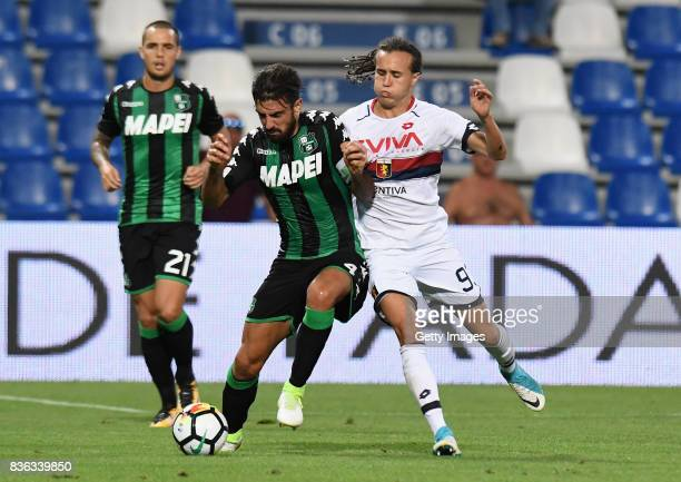 Francesco Magnanelli of US Sassuolo competes for the ball whit Ricardo Centurion of Genoa CFC during the Serie A match between US Sassuolo and Genoa...