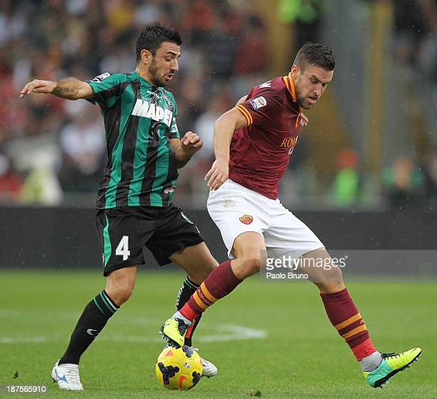 Francesco Magnanelli of US Sassuolo competes for the ball with Kevin Strootman of AS Roma during the Serie A match between AS Roma and US Sassuolo...