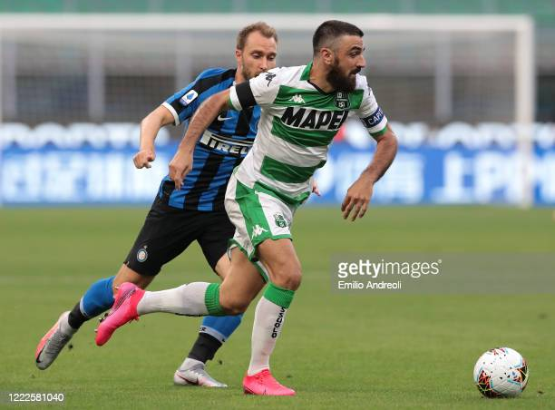 Francesco Magnanelli of US Sassuolo is challenged by Christian Eriksen of FC Internazionale during the Serie A match between FC Internazionale and US...