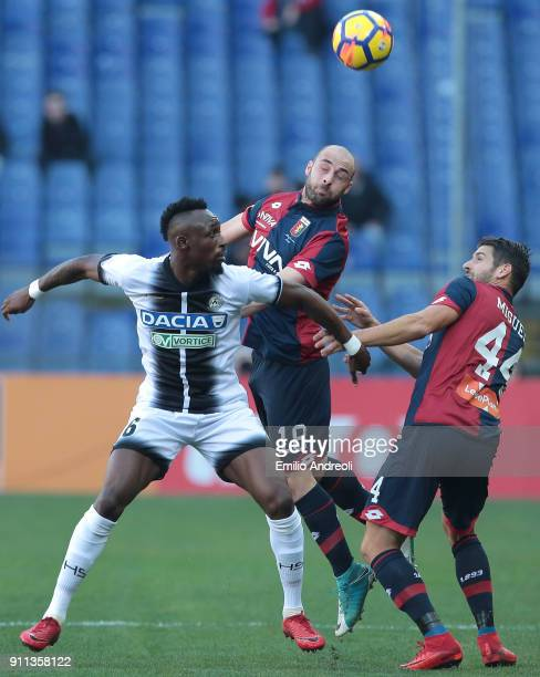 Francesco Migliore of Genoa CFC jumps for the ball against Seko Fofana of Udinese Calcio during the serie A match between Genoa CFC and Udinese...