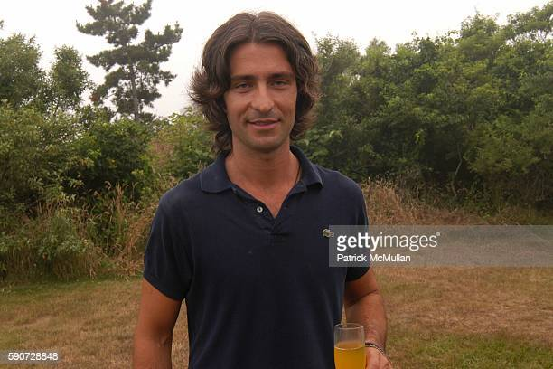 Francesco Mo attends Junko Yoshioka Presents Her Evening Wear Collection at Peter and Nejma Beard Residence on July 16 2005 in Montauk NY
