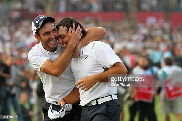 Francesco Molinari and Edoardo Molinari of Italy celebrate after winning the Omega Mission Hills World Cup on the Olazabal course on November 29 2009...