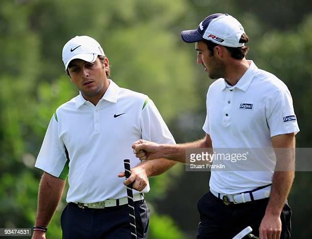 Francesco Molinari and Edoardo Molinari of Italy celebrate on the fifth hole during Foursomes on the final day of the Omega Mission Hills World Cup...