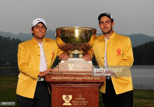 Francesco Molinari Edoardo Molinari of Italy hold the trophy after winning the Omega Mission Hills World Cup on the Olazabal course on November 29...