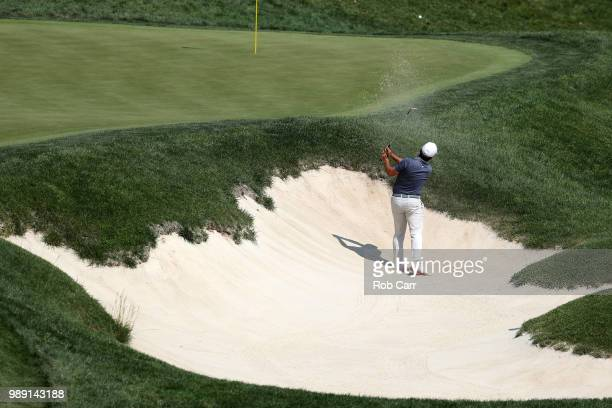 Francesco Molinari hits out of a bunker on the ninth hole during the final round of the Quicken Loans National at TPC Potomac on July 1 2018 in...