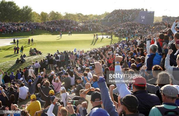 Francesco Molinari holes a putt on the 14th green to win the match 54 during the afternoon foursome matches of the 2018 Ryder Cup at Le Golf National...