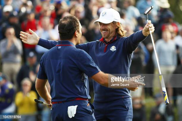 Francesco Molinari of Europe and Tommy Fleetwood of Europe celebrate on the 14th during the afternoon foursome matches of the 2018 Ryder Cup at Le...