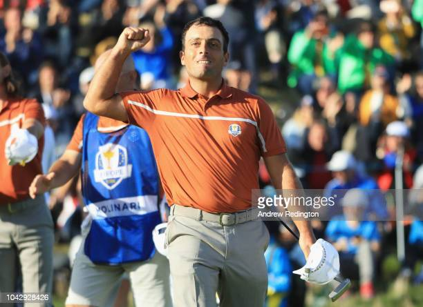 Francesco Molinari of Europe celebrates winning his match on the 14th during the afternoon foursome matches of the 2018 Ryder Cup at Le Golf National...
