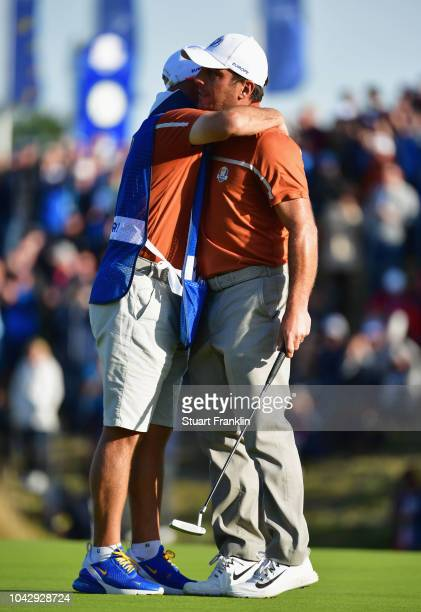 Francesco Molinari of Europe celebrates winning his match with caddie Pello Iguaran on the 14th during the afternoon foursome matches of the 2018...