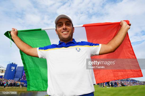 Francesco Molinari of Europe celebrates winning The Ryder Cup with an Italian flag during singles matches of the 2018 Ryder Cup at Le Golf National...