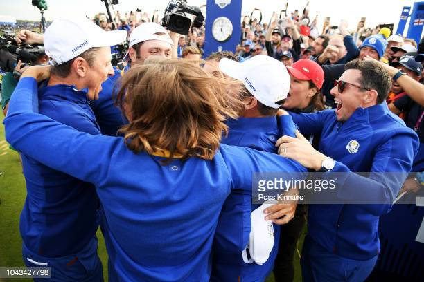 Francesco Molinari of Europe celebrates winning The Ryder Cup with members of the European team during singles matches of the 2018 Ryder Cup at Le...