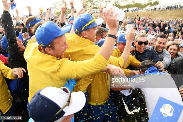 Francesco Molinari of Europe is showered with beer as he celebrates winning The Ryder Cup during singles matches of the 2018 Ryder Cup at Le Golf...